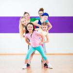 Kids train Zumba fitness in dancing school