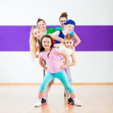 Kids train Zumba fitness in dancing school